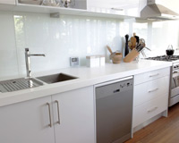 Glass splashback in modern kitchen