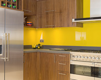 Glass splashback adds colour highlight to kitchen