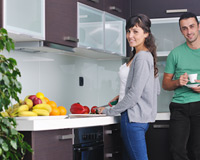 A couple enjoying their modern kitchen