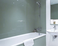 A glass splashback in a bathroom